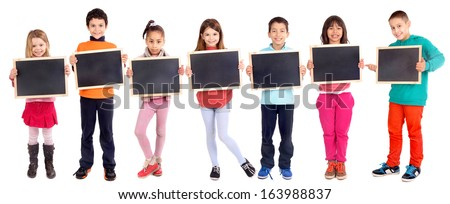 group of kids holding blackboard isolated in white - stock photo