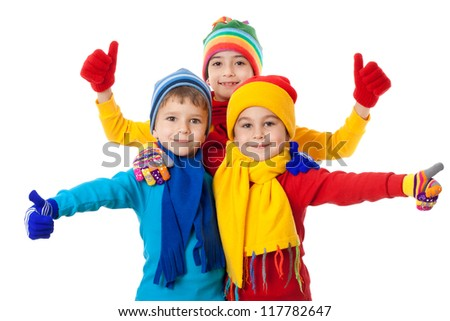 Group of kids in bright winter clothes and ok sign, isolated on white - stock photo