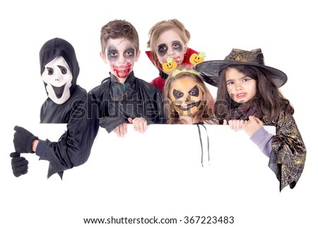 group of kids on halloween isolated in white - stock photo