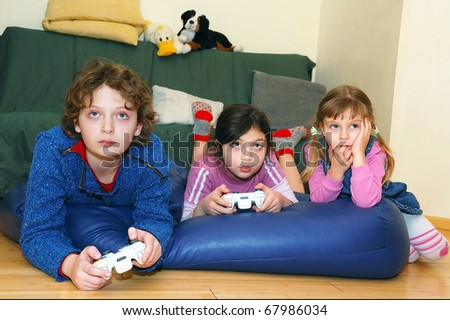 group of kids playing a video game - stock photo