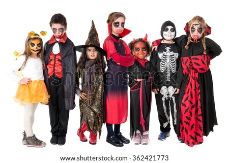 Group of kids with face-paint and Halloween costumes  - stock photo