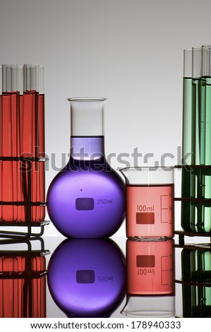 group of laboratory flasks with colored liquid - stock photo