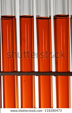 group of laboratory test tubes with red liquid inside - stock photo