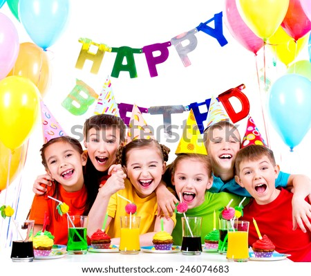 Group of laughing kids having fun at the birthday party - isolated on a white. - stock photo