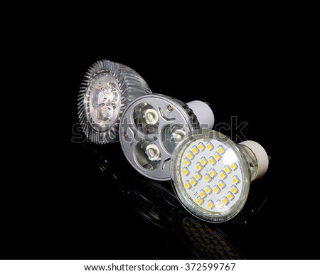 Group of 3 LED lamps in a row isolated on black - stock photo