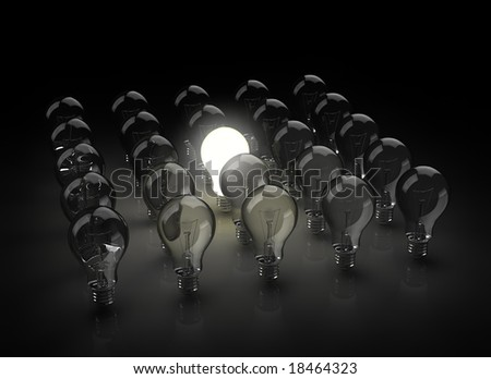 group of light bulbs with one glowing - stock photo