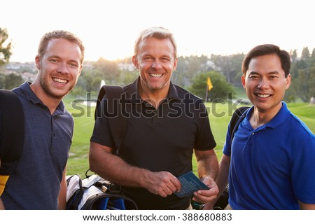 Group Of Male Golfers Marking Scorecard At End Of Round - stock photo