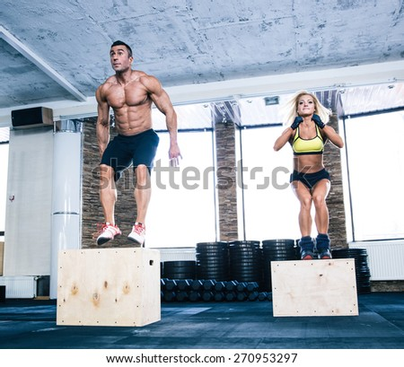 Group of man and woman working out with fit box at gym - stock photo