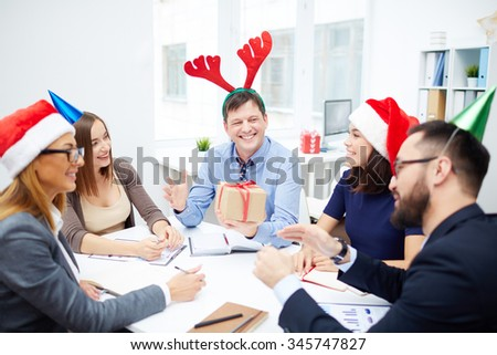 Group of managers working in office on Christmas day - stock photo