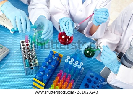 Group of medical doctors in laboratory. Scientific research. - stock photo