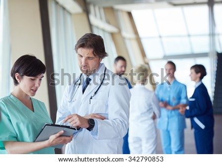 group of medical staff at hospital, doctors team standing together - stock photo