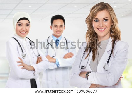 group of medical workers isolated over white background - stock photo