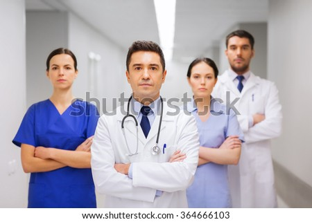 group of medics or doctors at hospital - stock photo