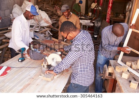 Group of men at work in a carpentry workshop, South Africa - stock photo