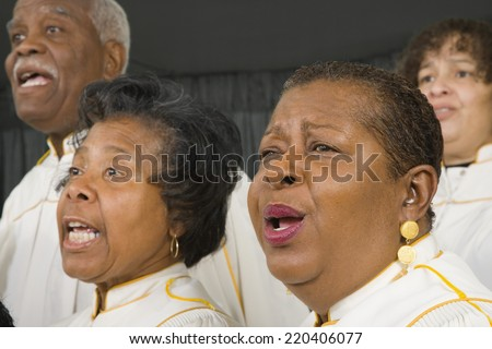 Group of middle-aged African people singing - stock photo