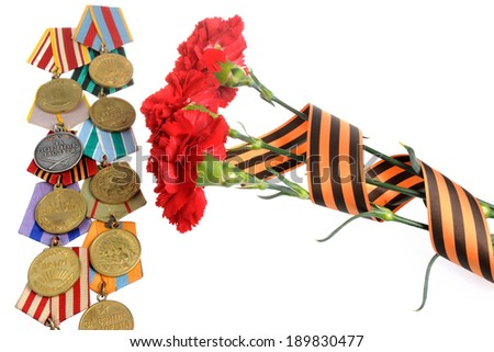 Group of military soviet medals of Great Patriotic war with red cloves isolated - stock photo