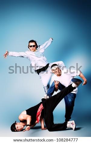 Group of modern dancers dancing hip-hop at studio. - stock photo