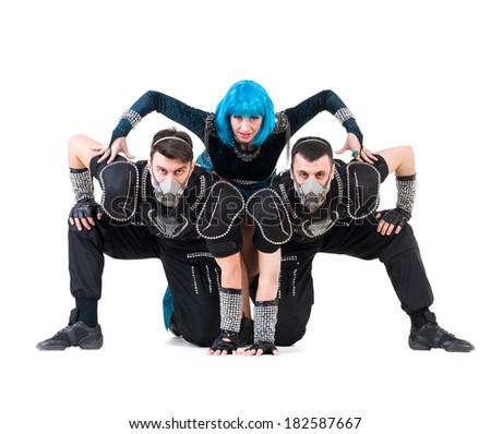 Group of modern dancers dressed as rebels posing. Isolated on white background in full length. - stock photo