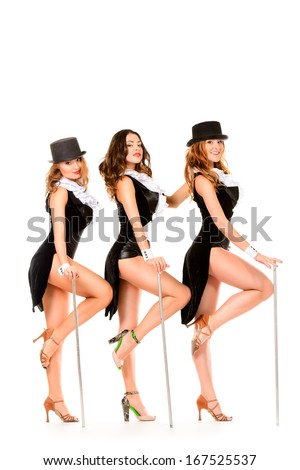 Group of modern professional dancers posing at studio. Isolated over white. - stock photo