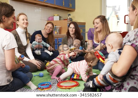 Group Of Mothers With Babies At Playgroup - stock photo