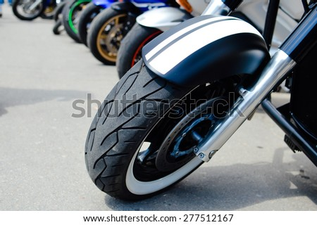 Group of motorbikes parked together - stock photo