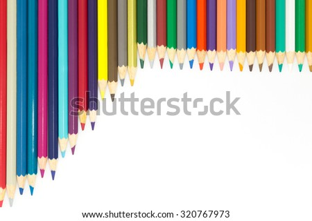 Group of multi colour wooden pencils on white background - stock photo