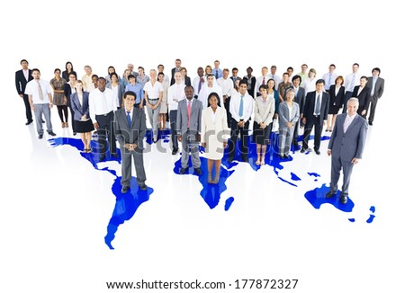 Group of Multi-Ethnic Business Colleagues Standing on a World Map Background - stock photo