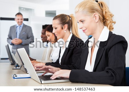 Group Of Multi Ethnic Businesspeople Working Together In Office - stock photo