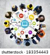 Group Of Multi-Ethnic People Working On Digital Devices Around Table - stock photo