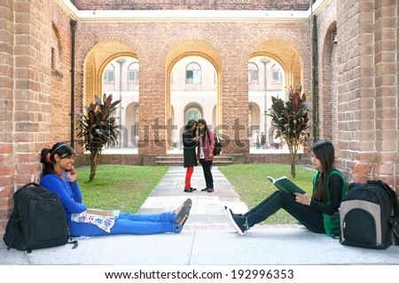 Group of multi-ethnic students in Indian university. - stock photo