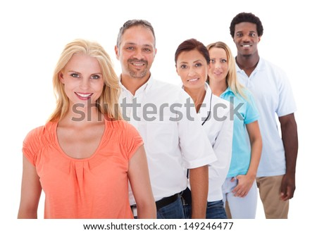 Group Of Multi-racial People Standing In A Row On White Background - stock photo