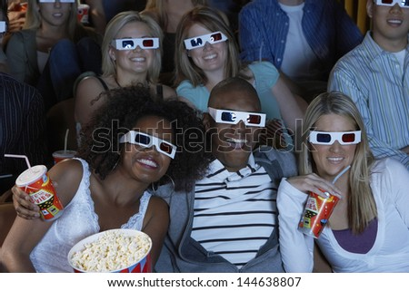 Group of multiethnic audience watching 3D movie - stock photo