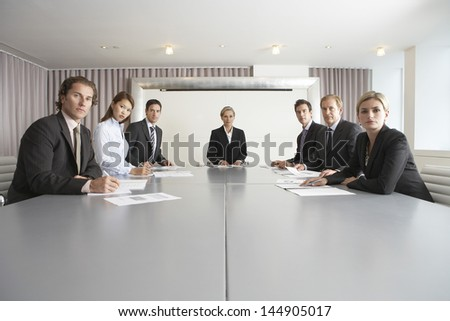 Group of multiethnic business people at conference table - stock photo