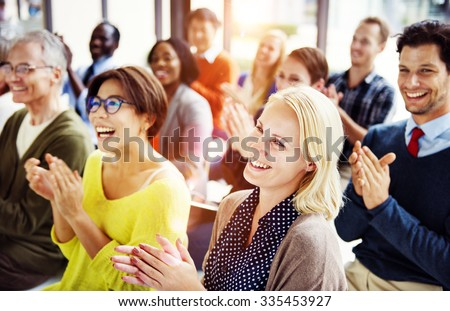 Group of Multiethnic Cheerful People Applauding Concept - stock photo