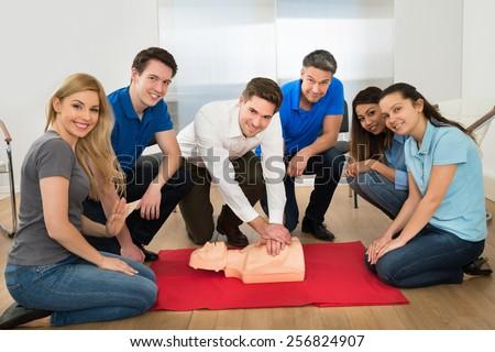 Group Of Multiethnic People In Resuscitation Training - stock photo