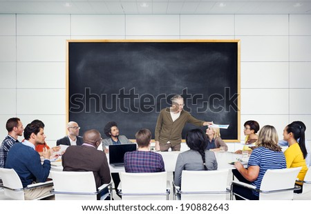 Group of Multiethnic Students Listening to the Speaker - stock photo