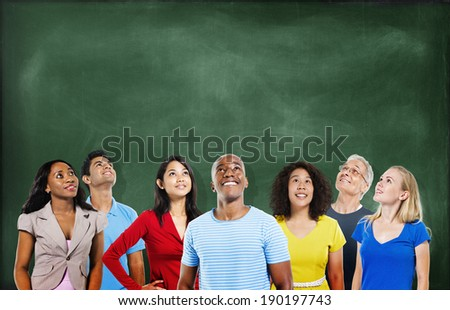Group of Multiethnic Students Looking Up with Blackboard - stock photo