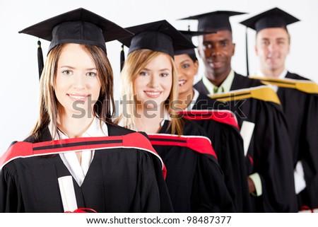 group of multiracial graduates at graduation - stock photo