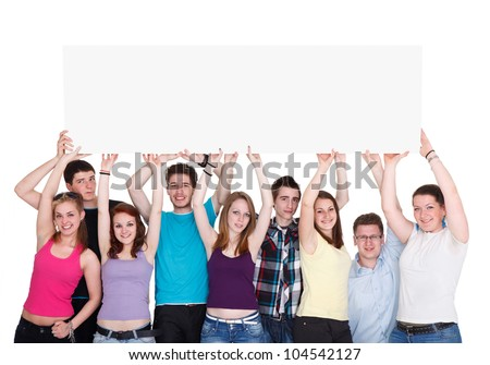 Group of nine young smiling people holding blank banner over their heads - stock photo