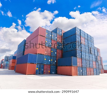 group of numerous shipping containers in port  with blue sky - stock photo