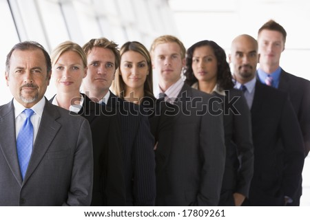 Group of office staff lined up facing camera - stock photo