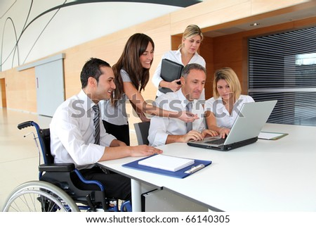Group of office workers in a business meeting - stock photo