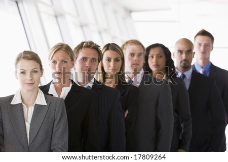 Group of office workers lined up facing camera - stock photo