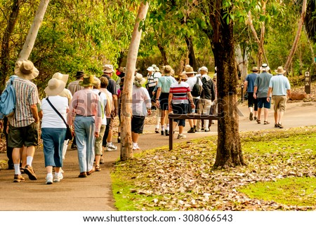 group of old and healthy people walking in the nature - stock photo