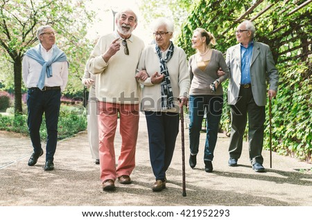 Group of old people walking outdoor - stock photo