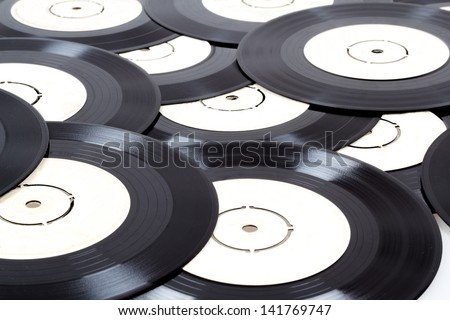 group of old small black vinyl records - stock photo