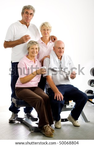 Group of older friends taking time out in the gym - stock photo