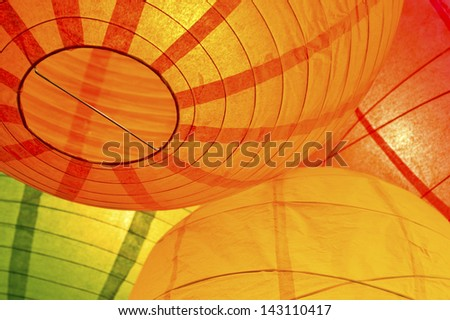 Group of paper lanterns hanging together - stock photo