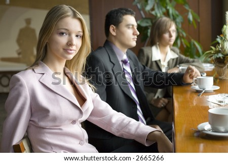 Group of People at the Cofe Table. Short Depth of Focus (On First Person's Face). - stock photo