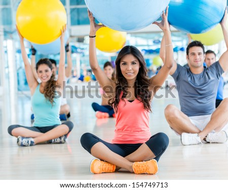 Group of people at the gym doing Pilates - stock photo